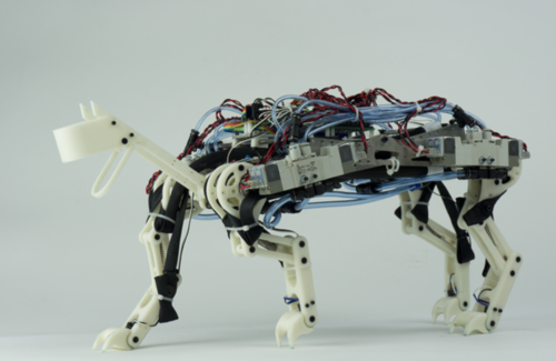 Development of a Minimalistic Pneumatic Quadruped Robot for Fast Locomotion